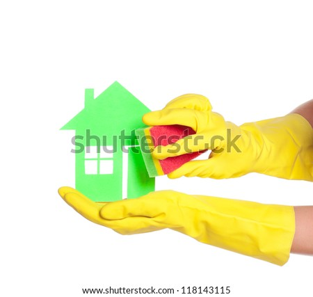 Paper house on woman hands in gloves with sponge isolated on white background - stock photo