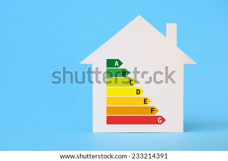 Paper house with energy efficiency chart - stock photo