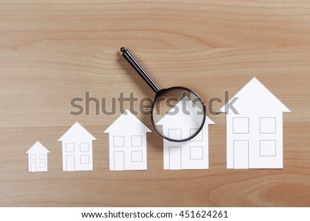 paper house with Magnifying Glass
