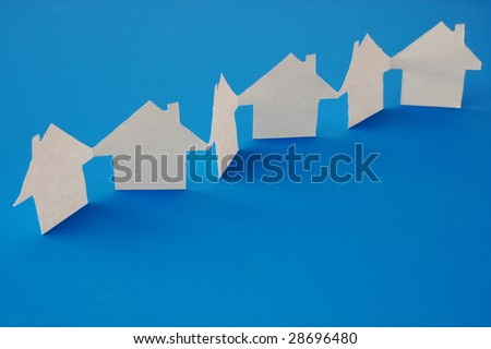 paper houses or homes showing a concept for real estate - stock photo