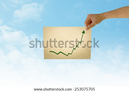 paper in man hand in stock on natural background There is space for you to add your text. - stock photo