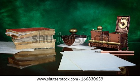 paper, ink pen, inkstand and paperweight on a glass table. - stock photo
