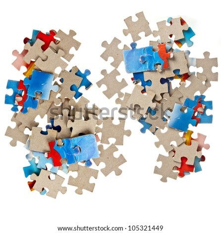 Paper jigsaw puzzle pieces isolated on white background - stock photo