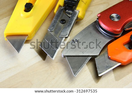 paper knife opener thin blades to cut paper and plastic - stock photo