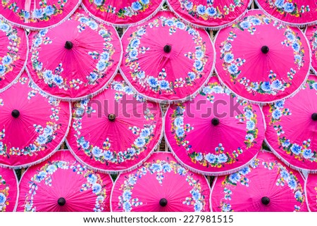 Paper Lanna umbrellas, Handmade umbrellas of Chiang Mai,North of Thailand. - stock photo