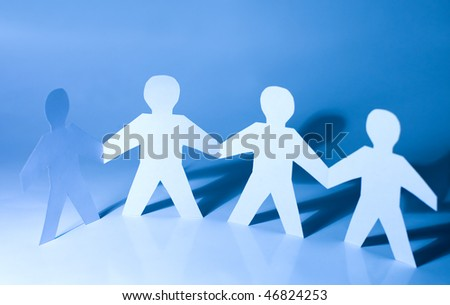 Paper little men holding hands - stock photo