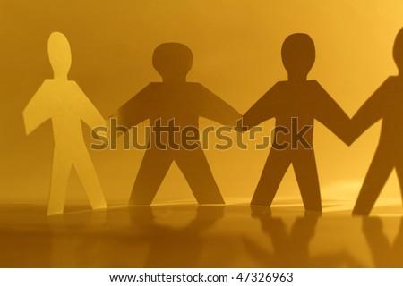 Paper little men holding hands - stock photo