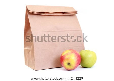 paper lunch bag with fresh apples on white - food and drink /focus on fruits/ - stock photo