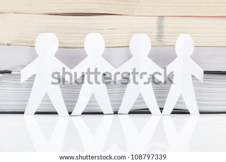 Paper man and book - stock photo