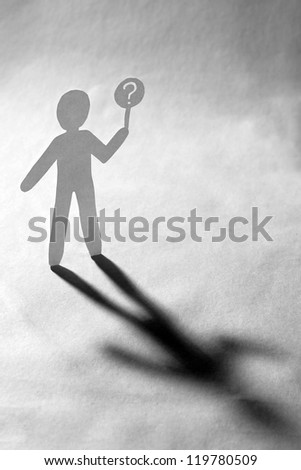 paper man holding a white billboard with a question mark on it - stock photo