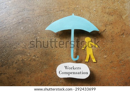 Paper man under an umbrella with Workers Compensation note underneath -- on the job injury concept                               - stock photo
