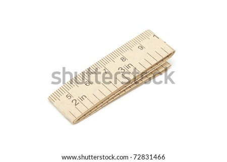 Paper measuring tape with centimeter and inch markings isolated on white - stock photo