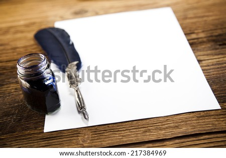 Paper message on wooden desk   - stock photo