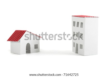 paper models of village and city dwelling houses with red roofs, isolated - stock photo