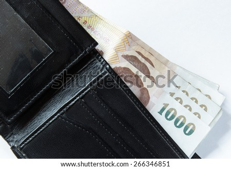 Paper money in Black Wallet on white background . Business concept. - stock photo