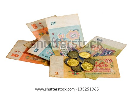 paper money of different denominations and several coins of yellow color on a white background. - stock photo