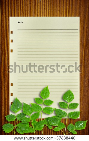 Paper note leaves on wood for text and background - stock photo