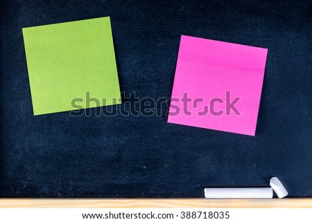 paper note on black board. blank notes. sticker note empty space for add text.  - stock photo