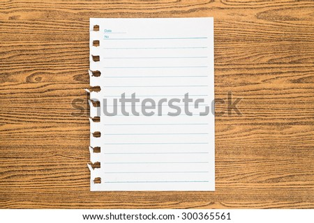 Paper note on wood table