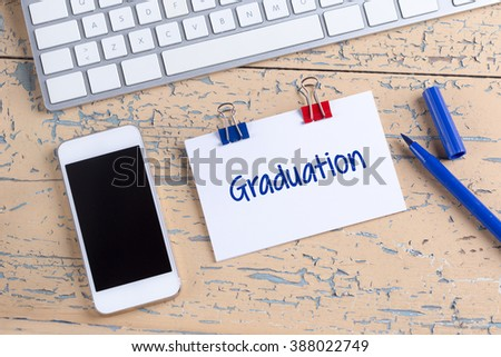 Paper note with text Graduation - stock photo