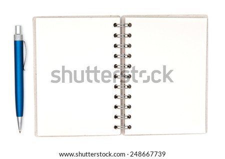 Paper notebook and pen on white background - stock photo