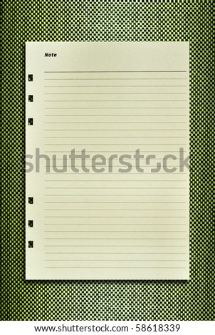Paper notebook on leather pattern background for text
