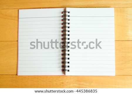 Paper notebook on wooden table  - stock photo