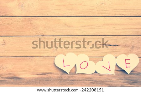 Paper of love on wood  - stock photo
