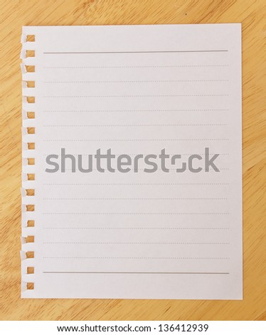Paper on a wooden table - stock photo