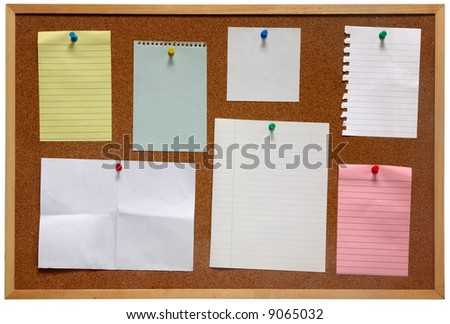 Paper on an isolated cork notice board. - stock photo