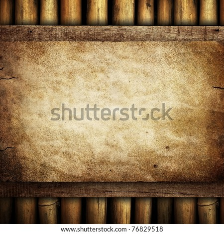 paper on bamboo background - stock photo