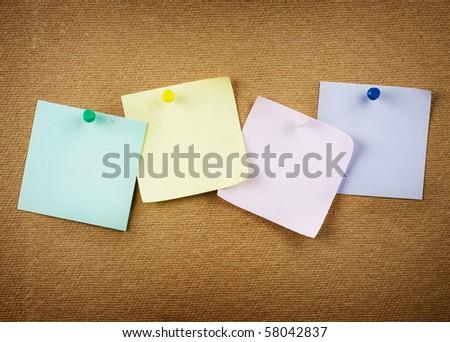 Paper on cork notice board - stock photo
