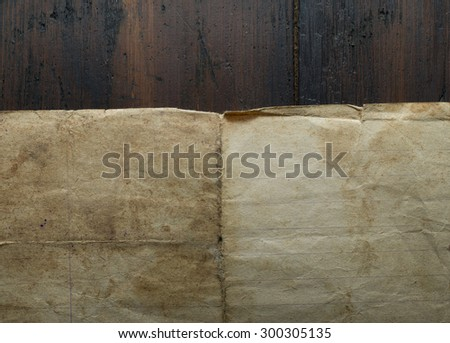paper on wood background - stock photo