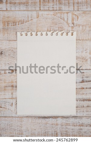 Paper on wood table for text and background - stock photo