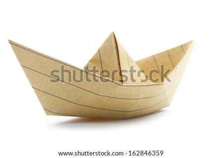 paper origami boat made with recycled paper isolated on white