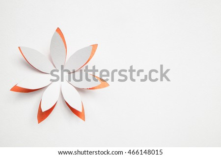 Paper origami flower on white background. Greeting card