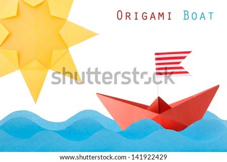 Paper origami red boat on the wave and sun on a white background - stock photo