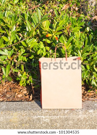 paper pack for shopping on green background - stock photo