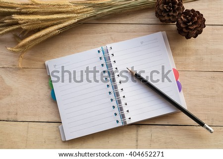 Paper page notebook with conceptual idea on wood background.