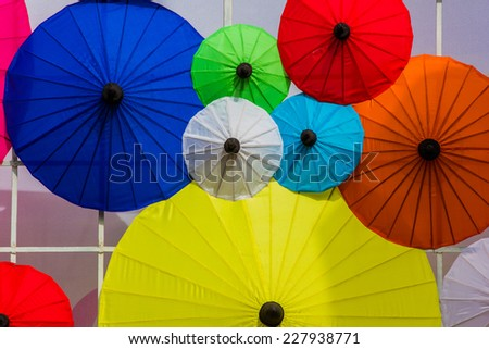 Paper parasols with the word Thailand painted on them.