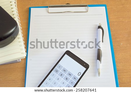 paper pen and calculator on the desk office - stock photo