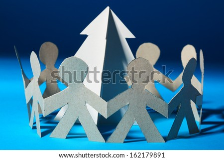 Paper people are dancing around Christmas tree - stock photo