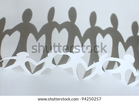 Paper people chain forming heart between figures - stock photo
