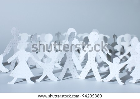 Paper people chain: men, women and babies. Family concept. - stock photo