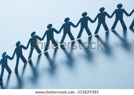 Paper people holding hands - stock photo