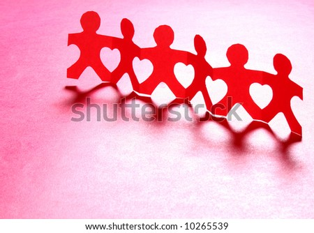 Paper people holding hands together making heart shapes - stock photo
