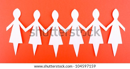 Paper people on red background - stock photo