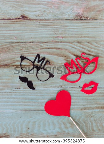 Paper people together in love on the  wooden background - stock photo
