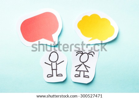 Paper people with colorful blank dialog speech bubbles. - stock photo
