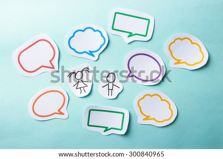 Paper people with colorful blank dialog speech bubbles. Social networking concept. - stock photo